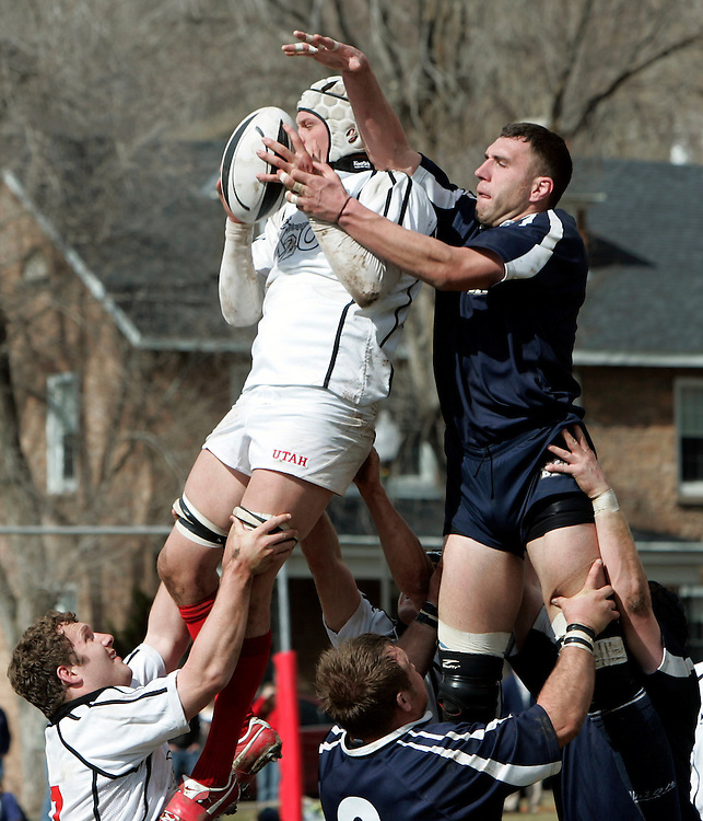Utah's Jake Anderson grabs the ball away from BYU's Craig Clark as BYU went on to defeat the University of Utah in Ruby 21-20 at Stillwell Field at Fort Douglas on the U of U Campus in Salt Lake City, Utah , Saturday, March 10, 2007. August Miller/ Deseret Morning News