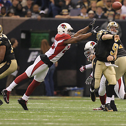 16 January 2010:  New Orleans Saints quarterback Drew Brees (9) throws the ball as Arizona Cardinals safety Adrian Wilson (24) provides pressure during the first half of the 2010 NFC Divisional Playoff game at the Louisiana Superdome in New Orleans, Louisiana.