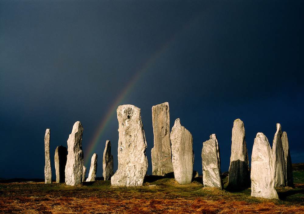 Callanish prehistoric stone circle on Outer Hebrides island of Lewis, Scotland. Over 5000 years old. Winter storm sky rainbow.