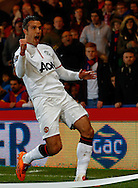 Robin van Persie of Manchester United celebrates scoring the opening goal during the Barclays Premier League match at Selhurst Park, London<br /> Picture by David Horn/Focus Images Ltd +44 7545 970036<br /> 22/02/2014