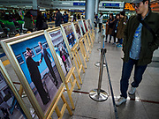 PAJU, GYEONGGI, SOUTH KOREA: A South Korean tourist looks at photos of the meetings between South Korean President Moon Jae-in and North Korean leader Kim Jong-un at Dorasan Station on the South Korean edge of the DMZ. The station was built in the early 2000s during a thaw in relations between the Koreas. It has never been used and is now a tourist site. Tourism to the Korean DeMilitarized Zone (DMZ) has increased as the pace of talks between South Korea, North Korea and the United States has increased. Some tours are sold out days in advance.      PHOTO BY JACK KURTZ