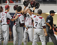 Arkansas' Travis Sample hits a grand slam off of Mississippi's Trent Rothlin in a college baseball game at Oxford-University Stadium in Oxford, Miss. on Friday, May 7, 2010. Arkansas won 11-4.