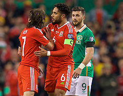 DUBLIN, REPUBLIC OF IRELAND - Friday, March 24, 2017: Wales' Joe Allen clashes with Republic of Ireland's Shane Long during the 2018 FIFA World Cup Qualifying Group D match at the Aviva Stadium. (Pic by David Rawcliffe/Propaganda)