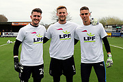 AFC Wimbledon goalkeeper George Long (1), AFC Wimbledon goalkeeper Joe McDonnell (24), AFC Wimbledon goalkeeper Nicola Tzanev (25) in LPF t shirts during the EFL Sky Bet League 1 match between AFC Wimbledon and Scunthorpe United at the Cherry Red Records Stadium, Kingston, England on 7 April 2018. Picture by Matthew Redman.