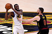 Jun 8, 2018; Cleveland, OH, USA; Golden State Warriors forward Draymond Green (23) handles the ball against Cleveland Cavaliers center Kevin Love (0) during the third quarter in game four of the 2018 NBA Finals at Quicken Loans Arena.