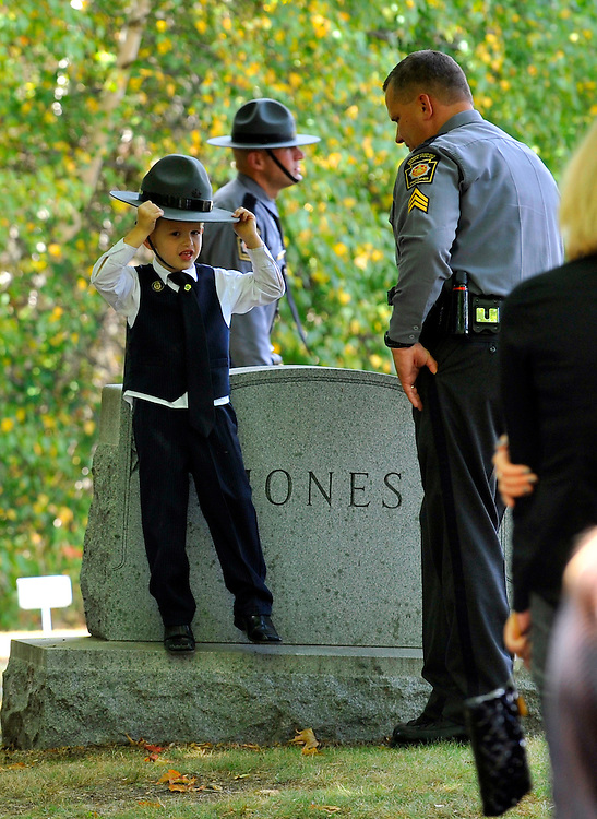The young son of CPL. Bryon Dickson wears a State Police campaign hat at the cemetery services for his dad. 091814 Aimee Dilger | The Times Leader