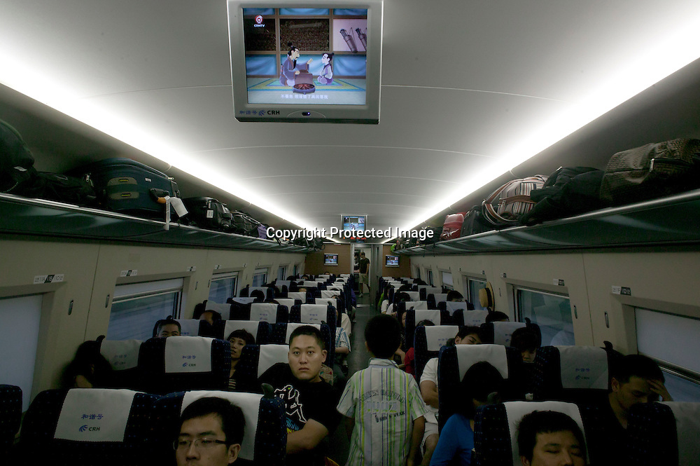 Beijing, September 11 , 2011 : a child walks through the aisle during the train ride to Beijing.the passenger-dedicated trunk line opened in June 2011, reducing the 1,318 km journey between Beijing and Shanghai to less than 5 hours. Trains reach top speeds of 300 km/h (186 mph) for the entire trip.