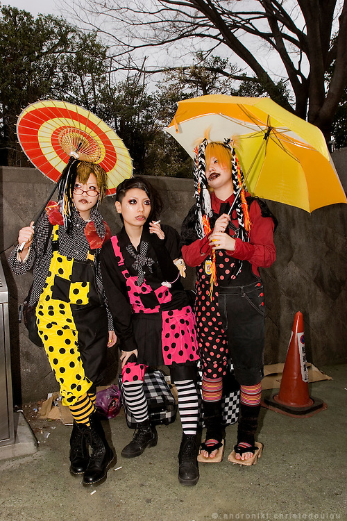 "Ei (left) Rui (center) and Rei (right) are dressed as the members of the cosplay music band ""Himitsu Kessya Kodomo"". Harajuku"