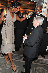 DENISE LEWIS, WILLIE CARSON and EDWIN MOSES at the 22nd Cartier Racing Awards held at The Dorchester, Park Lane, London on 13th November 2012.