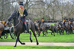 © Licensed to London News Pictures. 06/02/2013. London, UK The troop arrive in Green Park. The King's Troop Royal Horse Artillery, wearing immaculately presented full dress uniform, provide a colourful spectacle as they ride past Buckingham Palace today, 6th February 2013, to Green Park to stage a 41 Gun Royal Salute marking the 61st Anniversary of the Accession of Her Majesty The Queen. Photo credit : Stephen Simpson/LNP