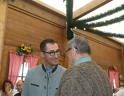 October 4, 2018 - Munich, Bavaria, Germany - Cem Oezdemir talking to a older citizen. The lead candidate of Buendnis 90 / Die Gruenen (The Greens) for the Bavarian State Elections went to the Oktoberfest with Cem Oezdemir, Eike Halitzky and the lead Candidate for the Gruene Jugend (Green Youth) Florian Siekmann. (Credit Image: © Alexander Pohl/NurPhoto/ZUMA Press)