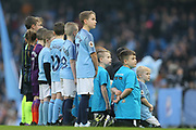 Mascots watch the screen whilst they wait for the teams entering the pitch during the The FA Cup 3rd round match between Manchester City and Rotherham United at the Etihad Stadium, Manchester, England on 6 January 2019.