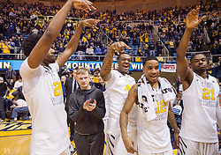 West Virginia players celebrate after beating the Texas Longhorns at the WVU Coliseum.