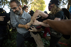 August 27, 2017 - Berkeley, California, U.S. - Anti-right-wing protesters wrestle with a man at MLK Jr. Civic Center Park during confrontations that broke out between Trump Demonstrators. (Credit Image: © Paul Kuroda via ZUMA Wire)