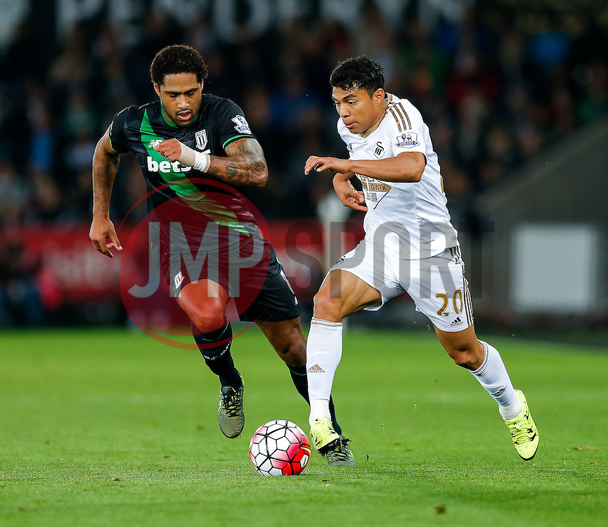 Jefferson Montero of Swansea City is challenged by Glen Johnson of Stoke City - Mandatory byline: Rogan Thomson/JMP - 07966 386802 - 19/10/2015 - FOOTBALL - Liberty Stadium - Swansea, Wales - Swansea City v Stoke City - Barclays Premier League.