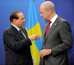Silvio Berlusconi, Italy's prime minister, left, speaks with Fredrik Reinfeldt, Sweden's prime minister and standing president of the European Council, as he arrives for the European Summit at the EU headquarters in Brussels, Belgium, on Thursday, Sept. 17, 2009. European Union leaders may call for sanctions on banks that pay excessive bonuses, fearing that runaway executive pay could trigger another financial crisis, a draft text showed. (Photo © Jock Fistick)