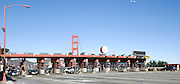 Drivers stop to pay the toll on the Golden Gate Bridge before driving into San Francisco, California