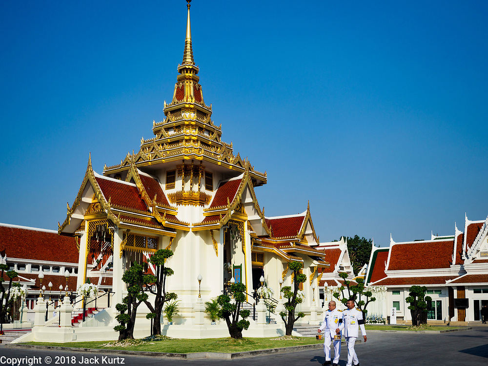 03 NOVEMBER 2018 - BANGKOK, THAILAND:  Participants in the funeral of Vichai Srivaddhanaprabha walk past the crematorium at Wat Debsirin on the first day of funeral rites for Vichai. Vichai was the owner of King Power, a Thai duty free conglomerate, and the Leicester City Club, a British Premier League football (soccer) team. He died in a helicopter crash at the King Power stadium in Leicester after a match on October 27. Vichai was Thailand's 5th richest man. The funeral is expected to last one week.   PHOTO BY JACK KURTZ
