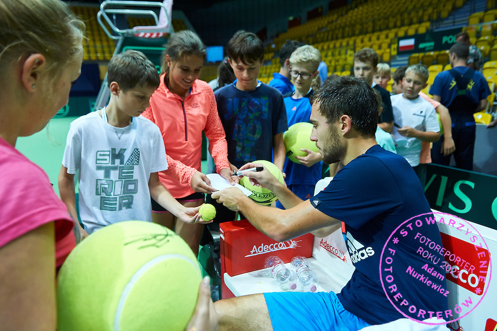 Jerzy Janowicz of Poland signs his autographs during training session one day before Davis Cup Tie World Group Play-off Poland v Slovakia at Mondo di Vinegre Restaurant in Gdynia, Poland.<br /> <br /> Poland, Gdynia, September 17, 2015<br /> <br /> Picture also available in RAW (NEF) or TIFF format on special request.<br /> <br /> For editorial use only. Any commercial or promotional use requires permission.<br /> <br /> Adam Nurkiewicz declares that he has no rights to the image of people at the photographs of his authorship.<br /> <br /> Mandatory credit:<br /> Photo by &copy; Adam Nurkiewicz / Mediasport