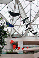 National Gallery, Washington DC, Calder Collection. Mobiles hanging from ceiling in the atrium.