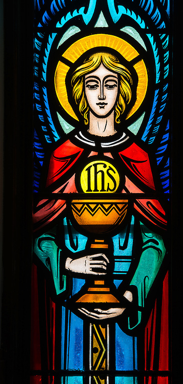 Stained glass window near the entrance of St. Therese Church in Appleton depicts an angel holding chalice and Blessed Sacrament. (Sam Lucero photo)