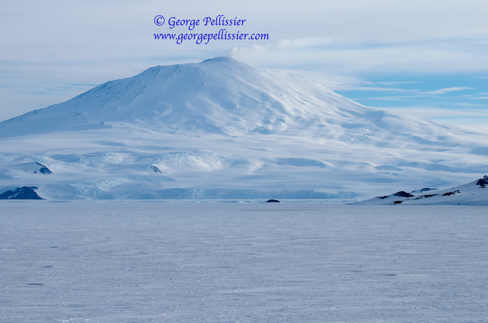 Mount Erebus, an Active Volcano on Ross Island, Antarctica.  In this shot you can see steam rising from the caldera at the top.