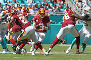 Sunday, October 13, 2019; Miami Gardens, FL USA;  Washington Redskins quarterback Case Keenum (8) fakes the handoff during an NFL game against Miami at Hard Rock Stadium. The Redskins beat the Dolphins 17-16. (Kim Hukari/Image of Sport)