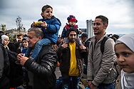 ATHENS, GREECE - FEBRUARY 04: Refugees stand at the Pireaus port after arriving by ferry from the Greek islands on February 04, 2015 in Athens, Greece. Thousands of refugees arrive every day by ferries fleet by private companies from the Greek islands to the Pireaus port. Photo: © Omar Havana. All Rights Are Reserved