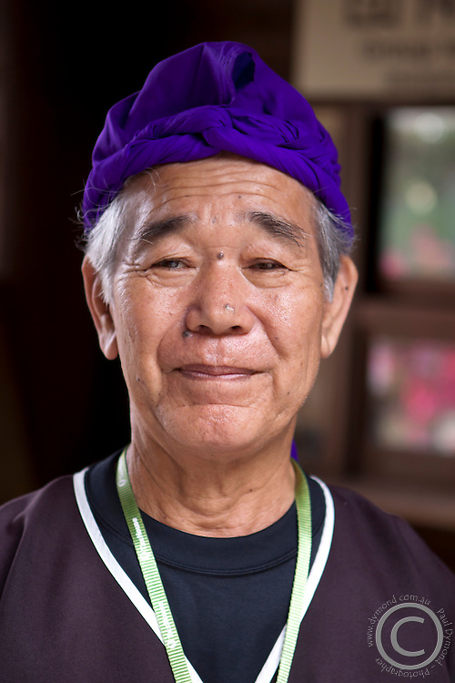 An elderly male worker at the Ryukyu Mura on the main island of Okinawa poses for the camera.