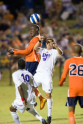 Virginia Cavaliers midfielder Tony Tchani (23) wins a header against SMU.  The #18 ranked Virginia Cavaliers fell to the #14 ranked Southern Methodist Mustangs 3-1 in NCAA men's soccer at Klockner Stadium on the Grounds of the University of Virginia in Charlottesville, VA on August 31, 2008.