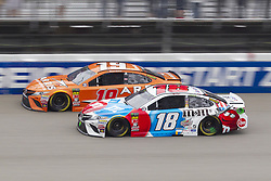 June 10, 2018 - Brooklyn, Michigan, U.S - NASCAR drivers DANIEL SUAREZ (19) and KYLE BUSCH (18) come out of turn four during the 50th Annual FireKeepers Casino 400 at Michigan International Speedway. (Credit Image: © Scott Mapes via ZUMA Wire)