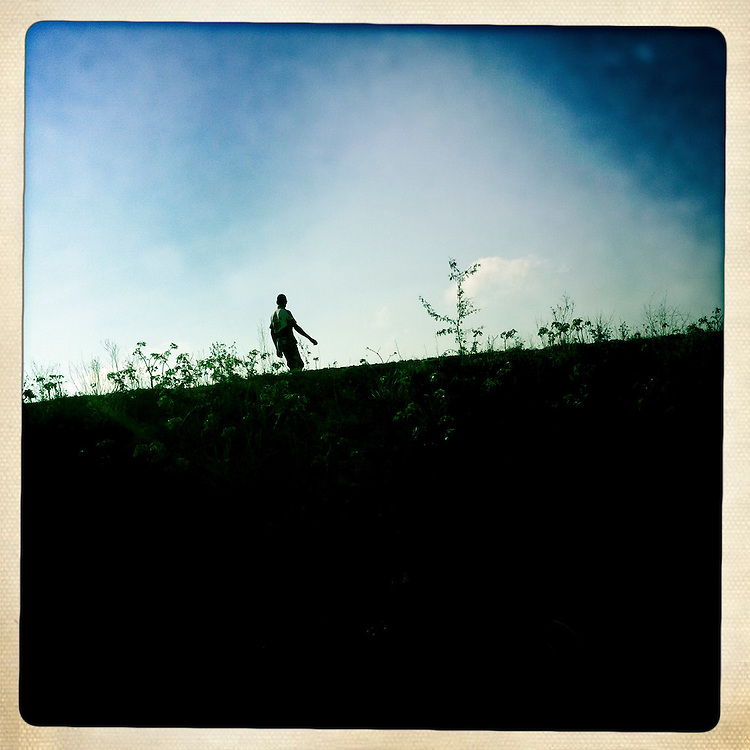 A boy walks along a ride at the Corail camp on Friday, April 6, 2012 in Port-au-Prince, Haiti.