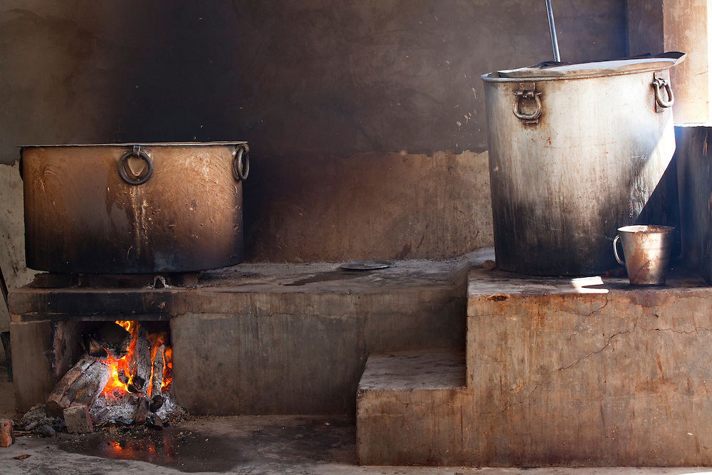 A part of a Sikh kitchen in one of the many Sikh temples in Punjab, India.The large pots are needed in order to feed the many pilgrims.