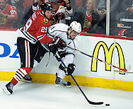 The Kings' Anze Kopitar battles for the puck with the Blackhawks' Bryan Bickell during the first overtime period of Game 5 of the Western Conference Final of the 2014 NHL Stanley Cup Playoffs at United Center in Chicago Wednesday.