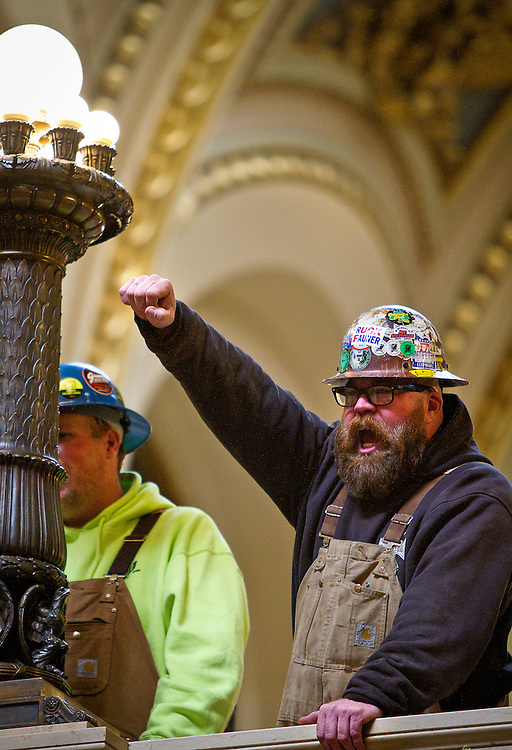 MADISON, WI — FEBRUARY 24: Kevin Flynn with Local 150 Chicago chants in the Rotunda of the Wisconsin State Capitol on Tuesday, February 24. Workers and labor unions rallied in opposition to a right-to-work bill being discussed in the state legislature.