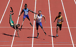 July 17, 2017 - London, United Kingdom - Great Britain's RICHARD WHITEHEAD (2nd from Right) goes onto to win as South Africa NTANDO MAHLANGU (L) falls during the Men's 100m T42 heat at the World Para Athletics Championships 2017, Day Four, London Stadium, London, UK.  (Credit Image: © Henry Browne/Action Images via ZUMA Press)