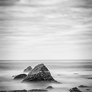 Battery Point, Crescent City, California, long exposure with surf and exposed rocks, black and white