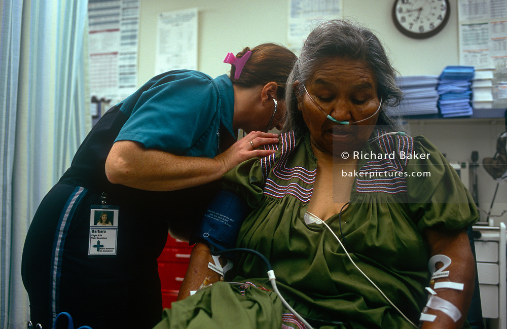 An elderly Apache lady patient receives specialist care from a dedicated air ambulance service for Arizona's Native Americans, on 25th August 1998, at Phoenix Native American reservation Hospital, Arizona, USA.