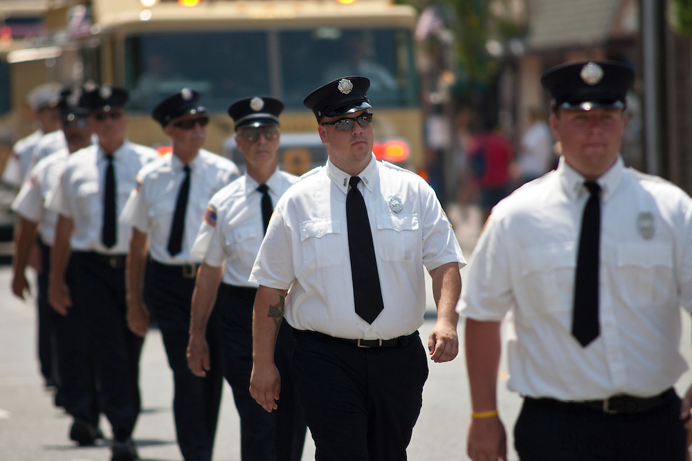 Members of the Pitman FIre Patrol walk down Broadway during the 2010 Pitman NJ annual 4th of July parade held on Monday July 5th.