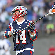 Ryan Boyle #14 of the Boston Cannons looks to pass the ball during the game at Harvard Stadium on May 17, 2014 in Boston, Massachuttes. (Photo by Elan Kawesch)