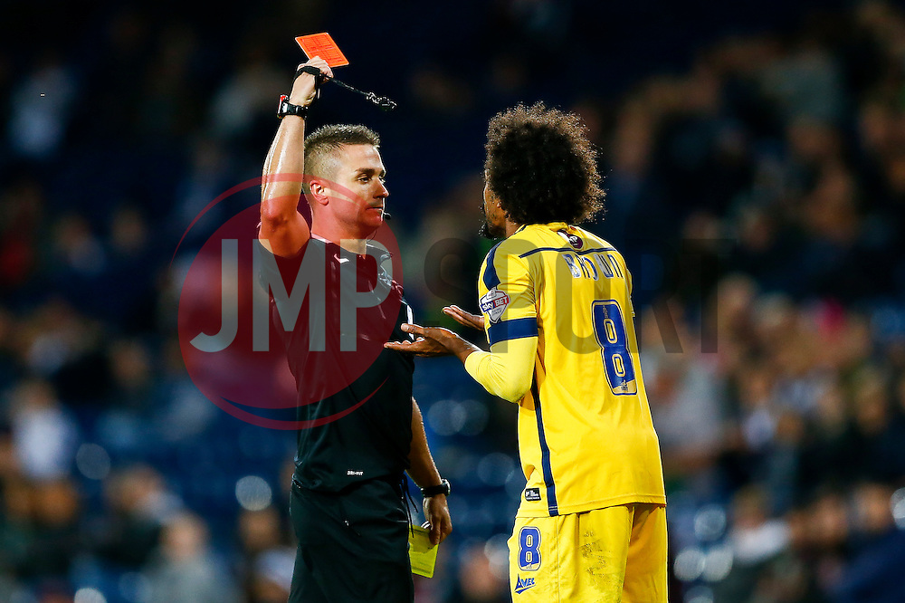 Junior Brown of Oxford United is shown a red card by referee James Adcock in extra time after a second yellow - Photo mandatory by-line: Rogan Thomson/JMP - 07966 386802 - 26/08/2014 - SPORT - FOOTBALL - The Hawthorns, West Bromwich - West Bromwich Albion v Oxford United - Capital One Cup Round 2.