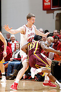 BLOOMINGTON, IN - JANUARY 12: Cody Zeller #40 of the Indiana Hoosiers defends against Maverick Ahanmisi #13 of the Minnesota Golden Gophers at Assembly Hall on January 12, 2012 in Bloomington, Indiana. Minnesota defeated Indiana 77-74. (Photo by Joe Robbins)