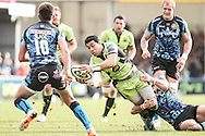 George Pisi of Northampton Saints (centre) is tackled during the LV Cup Final match at Sandy Park, Exeter<br /> Picture by Andy Kearns/Focus Images Ltd 0781 864 4264<br /> 16/03/2014