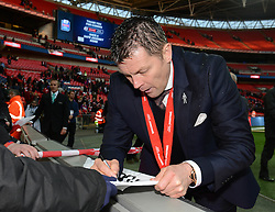 Bristol City manager, Steve Cotterill signs autographs for fans after the win against Walsall in the Johnstone Paint Trophy - Photo mandatory by-line: Dougie Allward/JMP - Mobile: 07966 386802 - 22/03/2015 - SPORT - Football - London - Wembley Stadium - Bristol City v Walsall - Johnstone Paint Trophy Final