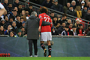 Manchester United Manager Jose Mourinho consoles Manchester United Midfielder Marouane Fellaini after being a substitute during the Premier League match between Tottenham Hotspur and Manchester United at Wembley Stadium, London, England on 31 January 2018. Photo by Phil Duncan.