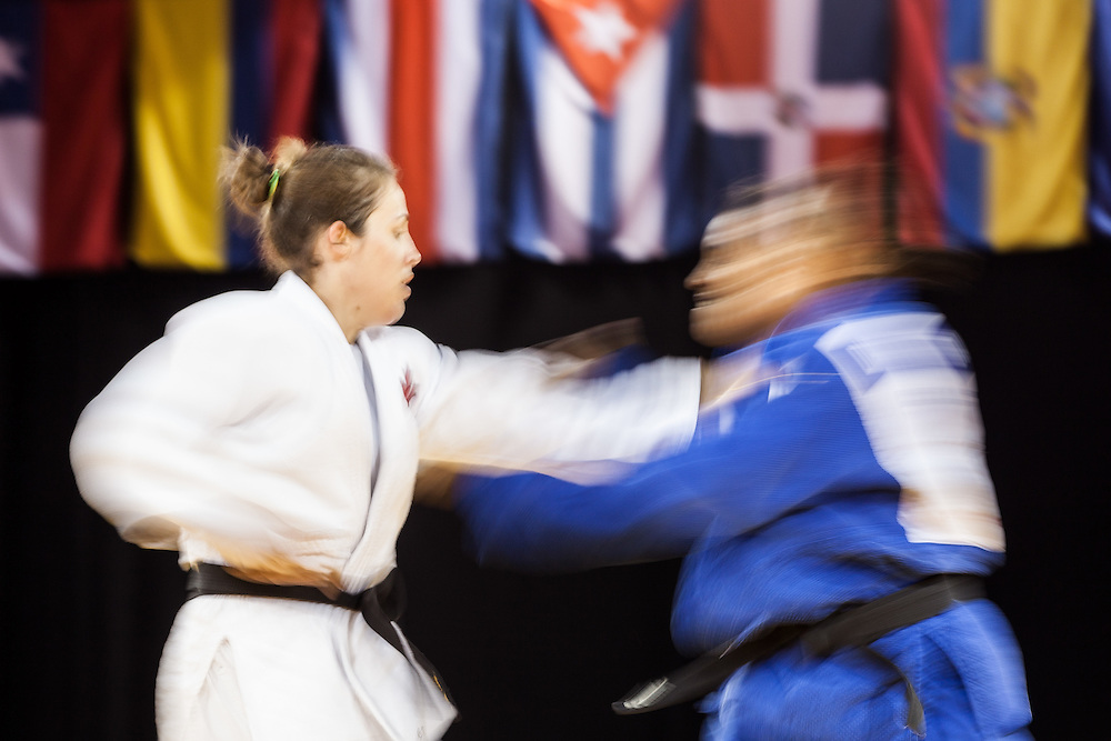 Catherine Roberge (L) of Canada and Diana Chala of Ecuador struggle for position in their women's judo -78kg class contest at the 2015 Pan American Games in Toronto, Canada, July 14,  2015.  AFP PHOTO/GEOFF ROBINS