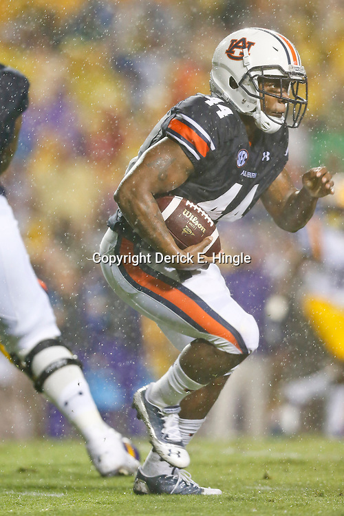 Sep 21, 2013; Baton Rouge, LA, USA; Auburn Tigers running back Cameron Artis-Payne (44) runs against the LSU Tigers during the first quarter of a game at Tiger Stadium. Mandatory Credit: Derick E. Hingle-USA TODAY Sports