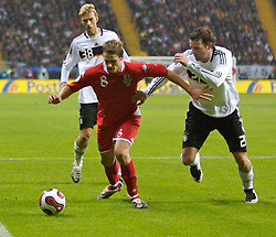 FRANKFURT, GERMANY - Wednesday, November 21, 2007: Wales' David Edwards and Germany's Christoph Metzelder during the final UEFA Euro 2008 Qualifying Group D match at the Commerzbank Arena. (Pic by David Rawcliffe/Propaganda)
