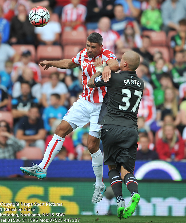 LIVERPOOLS MARTIN SKRTEL PUSHES OF STOKES JONATAHN WALTERS, Stoke City v Liverpool, Premiership, Britannia Stadium Sunday 9th August 2015