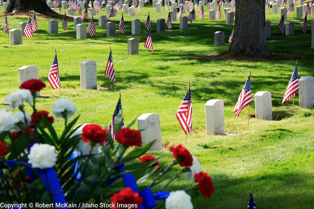 IDAHO. Boise. Morris Hill Cemetery, Silent Camp. Flags on military gravestones on Memorial Day. May 2006 #hm060109